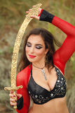 Dance with a sword. Tribal style Royalty Free Stock Photography