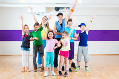 Dance teacher giving kids Zumba fitness class Stock Images
