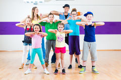 Dance teacher giving kids Zumba fitness class Royalty Free Stock Photos