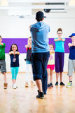 Dance teacher giving kids Zumba fitness class Royalty Free Stock Photography