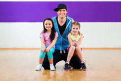 Dance teacher giving kids Zumba fitness class Royalty Free Stock Photo