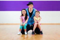 Dance teacher giving kids Zumba fitness class Royalty Free Stock Photo