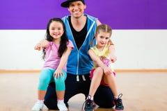 Dance teacher giving kids Zumba fitness class Royalty Free Stock Photography
