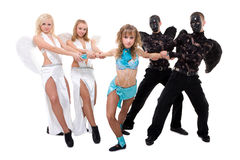 Dance team dressed as angels and demons Stock Images