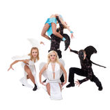 Dance team dressed as angels and demons dancing Stock Photo