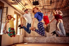 Dance team - happy dance friends jumping during music royalty free stock photography