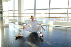 Dance trainer doing backwards close up somersault . Young dancer doing close up backwards somersault . Male person training at gym studio. Concept of royalty free stock photos