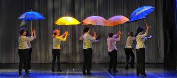 Dance with umbrellas Royalty Free Stock Photos