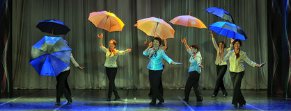 Dance with umbrellas Royalty Free Stock Images