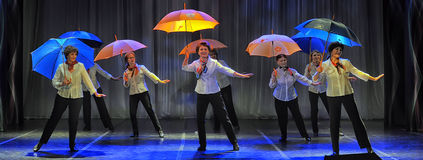 Dance with umbrellas Royalty Free Stock Image