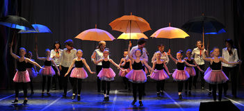 Dance with umbrellas Royalty Free Stock Photo