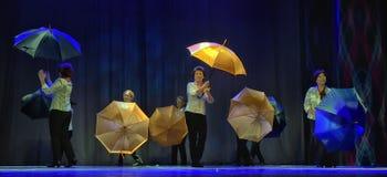 Dance with umbrellas Stock Image