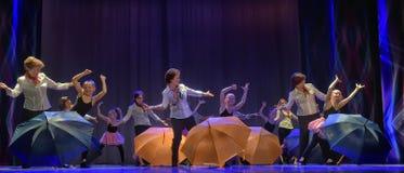 Dance with umbrellas Stock Photo