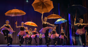 Dance with umbrellas Stock Photography