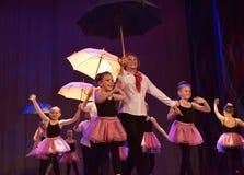 Dance with umbrellas Stock Photos