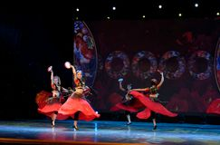 Send you a rose 3 -Chinese national dance in Xinjiang. It is a dance widely distributed in the Uygur ethnic group, accompanied by the music of the king of the Stock Image