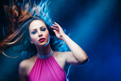 Dance woman. Dancing woman in pink dress and  hair in motion   studio shot Royalty Free Stock Photos