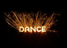 DANCE word in glowing sparkler. On dark background Royalty Free Stock Images