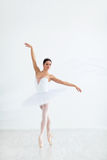 Dance. Young ballerina dancing in studio royalty free stock images