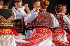 Dance of young Romanian dancers in traditional costume. ROMANIA, TIMISOARA - JULY 6, 2017: Dance of young Romanian dancers in traditional costume present at the stock photography