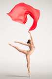 Dance with your dream. The lovely photo of a girl dancing with red cloth Royalty Free Stock Image