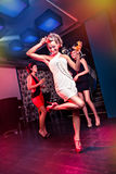 On the dancefloor. Group of young women on the dancefloor Royalty Free Stock Photos