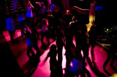 Dancefloor Frenzy. Motion blur shot of the silhouettes on a nightclub's dancefloor, a bit dark, but that's how it is in nightclubs Royalty Free Stock Images