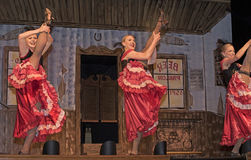 Dancehall Girls Entertaining. Can-can dancers perform at Diamond Tooth Gertie`s Gambling Hall in Dawson City in Canada`s Yukon Territory on July 24, 2017 Stock Image