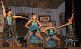 Dancehall Girls Entertaining. Can-can dancers perform at Diamond Tooth Gertie`s Gambling Hall in Dawson City in Canada`s Yukon Territory on July 24, 2017 Royalty Free Stock Photography