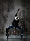 The dancer. Modern style dancer posing on dirty grunge background Stock Photos