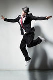 The dancer. Modern style dancer jumping on studio background Stock Photography