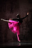 The dancer. Modern style dancer jumping on dirty grunge background Stock Photography
