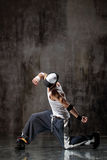 The dancer. Modern style dancer posing on dirty grunge background royalty free stock photos