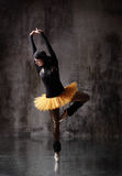 The dancer. Modern style dancer posing on dirty grunge background Stock Images