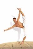 dancer. Flexible dancer with leg high in splits in a balance Stock Photography