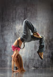 The dancer. Modern dancer poses in front of the gray wall Royalty Free Stock Images