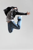 The dancer. Modern dancer poses in front of the gray wall Stock Image