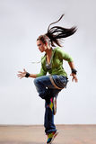 The dancer. Modern dancer poses in front of the gray wall stock photography