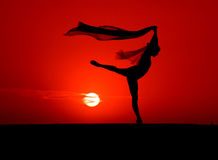 The Dancer. Silhouette of a ballet dancer posing in front of a spectacular sunset stock photo