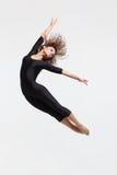 Dancer. Modern style dancer posing on studio background Royalty Free Stock Images