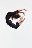 Dancer. Modern style dancer posing on studio background royalty free stock photos