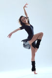 Dancer. Modern style dancer posing on studio background Royalty Free Stock Photos