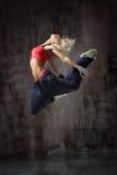 Dancer. Modern style dancer posing on studio background Stock Image