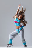 The dancer. Modern style dancer posing on studio background royalty free stock images