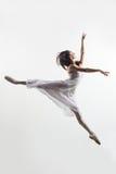 The dancer. Modern style dancer posing on studio background Stock Images