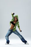The dancer. Modern style dancer posing on studio background Royalty Free Stock Photos