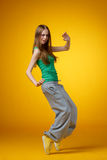 Dancer. Female breakdancer posing on yellow background Royalty Free Stock Photos