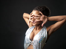 Dancer. African go-go dancer in a dance pose royalty free stock images