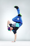 The dancer. Modern style dancer posing on studio background Stock Images
