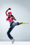 The dancer. Modern style dancer posing on studio background Stock Image
